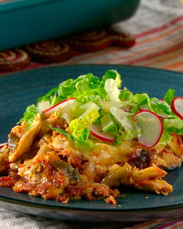 Budin Azteca - layered Mexican casserole. Served with a heaping mound of tangy salad over the top. Yum!