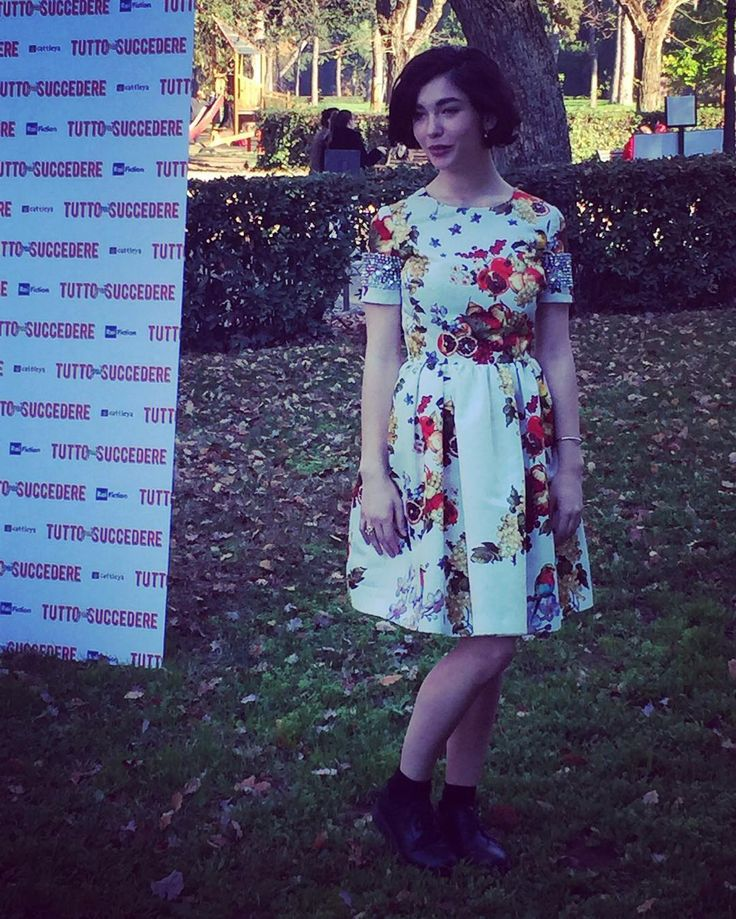 "Italian actress Matilda De Angelis in a silk duchesse dress with fruit and flower print and embroidered sleeves from the Blugirl Fall Winter 2015/2016 Fashion Show collection on the occasion of the ""Tutto può succedere"" Italian TV series press conference."