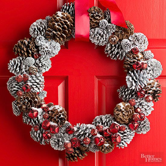 "Simple materials get a textural upgrade, thanks to a little dose of white spray paint to reference a dusting of snow. Vary the coverage of spray paint so some pinecones are fully ""snow covered"" and others are lightly dusted. Let dry. Use 8-inch pieces of florists wire to attach pinecones to a wire wreath form. Hot-glue red jingle bells to the wreath, placing most of them on the full-white pinecones to help the color pop./"