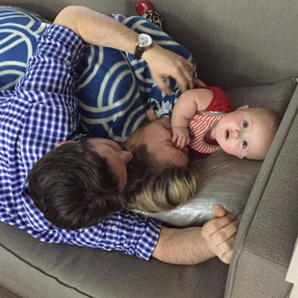 """How adorable are those chubby little cheeks?! """"Trying to take a nap before the iHeart Radio Awards .... haha didn't work :),"""" the doting mama captioned the pic in which she's snuggling on the couch with husband Brandon Blackstock and the couple's wee one, who is gazing at the camera and killing us with cuteness."""