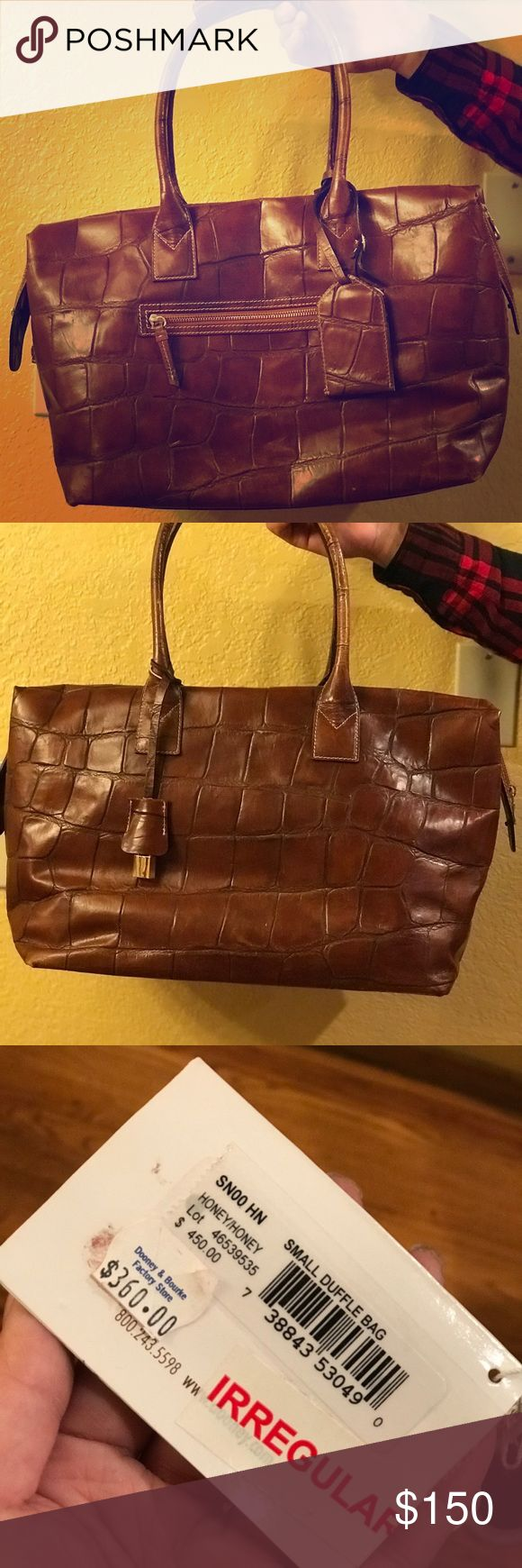Dooney & Bourke small luggage Dooney & Bourke small luggage origianally purchased in year 2000. Great condition. Dooney & Bourke Bags Travel Bags