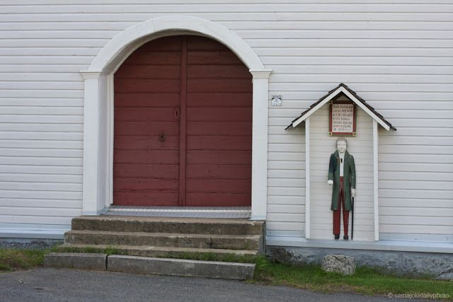 "Finnish ""Vaivaisukko"" is a wooden boy standing by the church of Nurmo. These statues can be found in many churches in Finland. The wooden statue has a coin-sized hole in it and people can donate money for the parish."