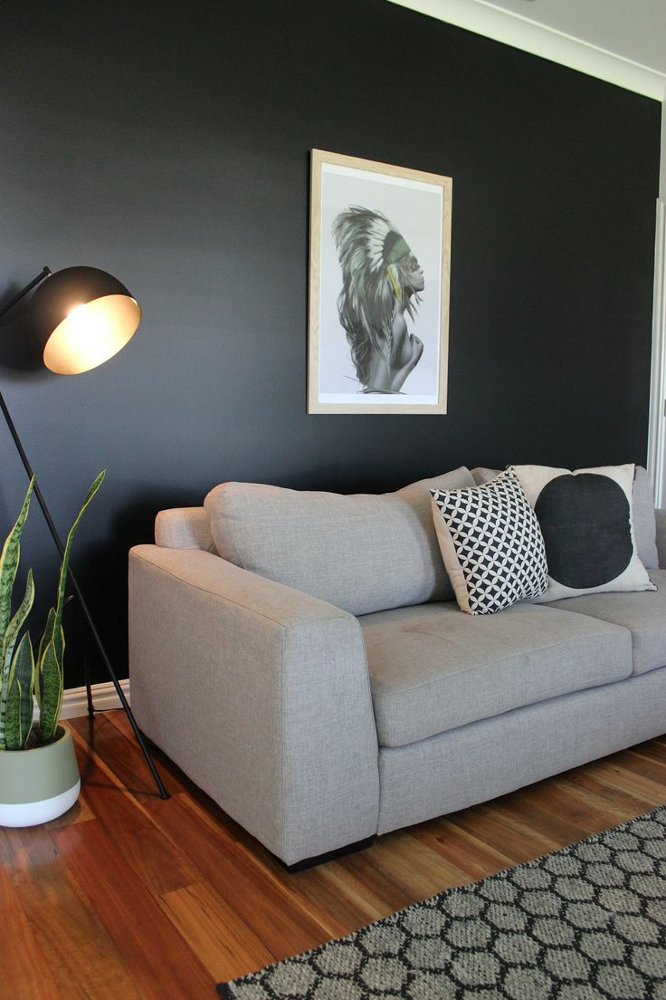 A black wall in the living room - Katrina Chambers
