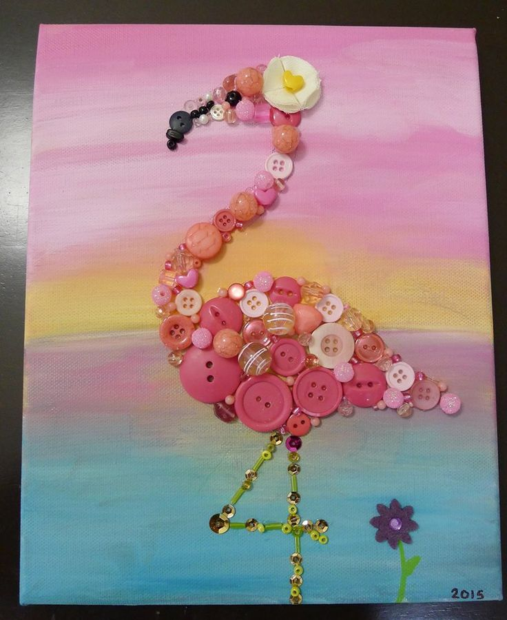 My little girl and I glued a bunch of buttons, beads and sequins on canvas to create some cute flamingo art for her fourth birthday party and then to hang in the playroom or the girls bedroom after the party!
