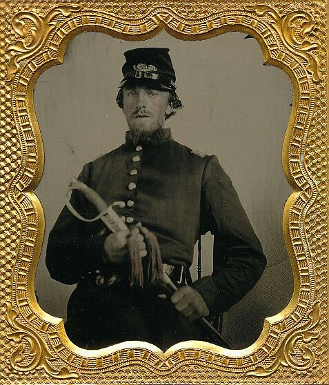 Beautiful early war sixth plate ruby ambrotype of a Federal infantry officer. Dressed in his spanking new frock. His forage cap has infantry insignia pinned to the front but it doesn't look like there are any numerals present. A pencil inscription behind the image dates when the image was taken and the place as Sept. 18th, 1861 in Reading, PA.