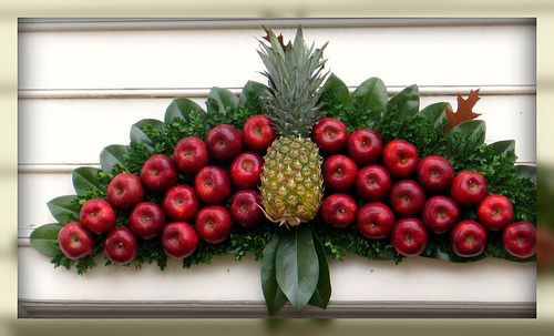 colonial decor - fruit above door.  Just a piece of board with nails.  stick on your fruit and there you have it.