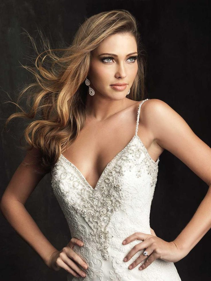 Fabulous ALLURE BRIDALS A slim fitted gown in all over lace The
