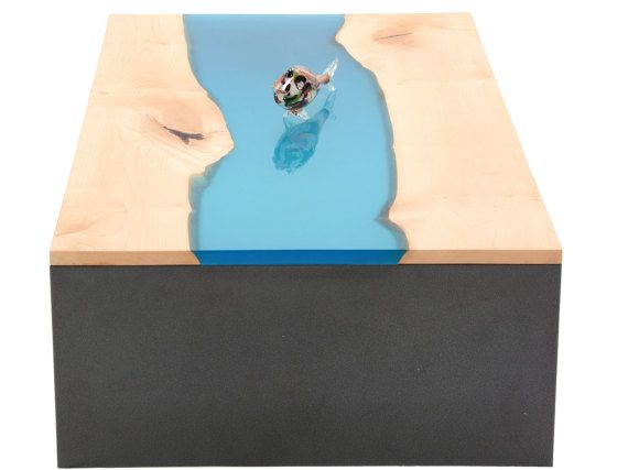 Modern coffee table is made from two pieces of carefully selected wood with live edge holding together by resin. This coffe table is suitable for your living room, office, showrooms, reception lounges, salons, cafés, bars, ...  WOOD: Comes from the Slovenian Julian Alps, which are part of the European Alps European Alps are the highest and most extensive mountain range system that lies entirely in Europe, stretching approximately 1,200 kilometres (750 mi) across eight Alpine countries…
