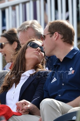 William and Kate watch Zara Phillips compete in the Equestrian event at the London Olympics. Nice to have royals that actually appear to love one another!