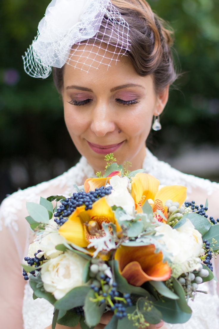 Bride sends a smile to her calla, cymbidium orchid, brunia, eucalyptus and David Austin roses autumnal bouquet. Photo credit: https://www.facebook.com/Twenty9Studio