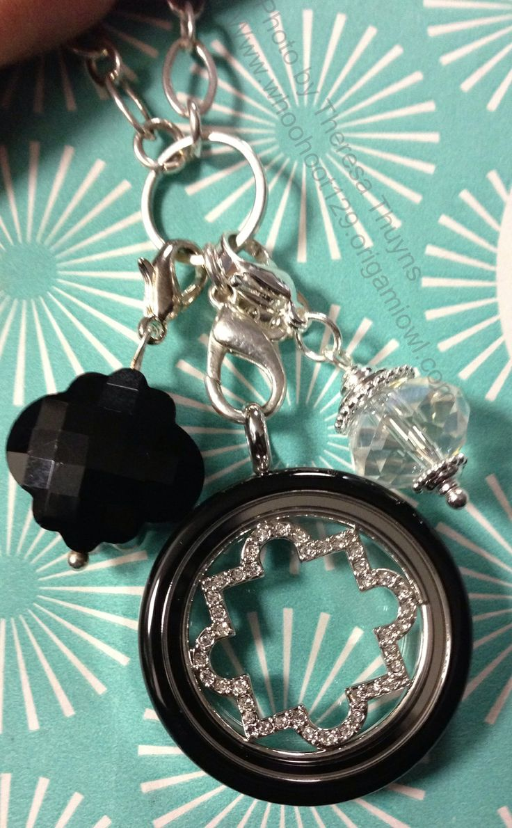 Origami owl Large Silver Twist locket with lil' black locket face.