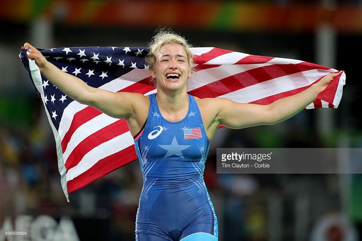 Day 13 Helen Louise Maroulis of the United States celebrates with the United States flag after winning the Gold Medal against Saori Yoshida of Japan in the Women's Freestyle 53 kg Final match at the Carioca Arena 2 on August 18, 2016 in Rio de Janeiro, Brazil.