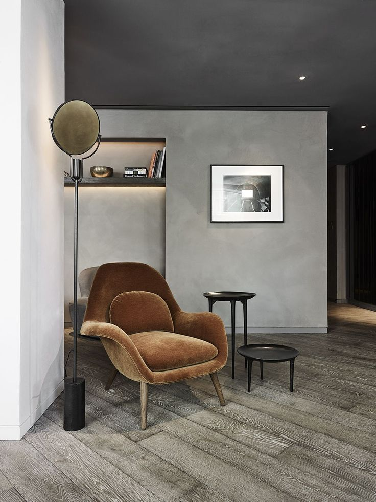 Stunning room in black and grey. The brown caramel armchair looks amazing. photo by Wichmann + Bendtsen Photography. Swoon armchair by Fredericia. Danish design by Space Copenhagen.