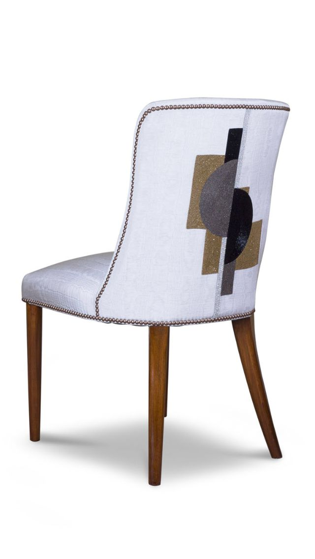 The beautiful Calypso dining chair in silk with Piet Art Deco style hand embroidery.