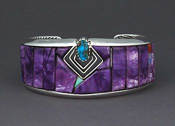 Cuff | Eddie Begay (Navajo). Sterling silver inlaid with sugilite with opal and coral accents and set with Red Mountain turquoise