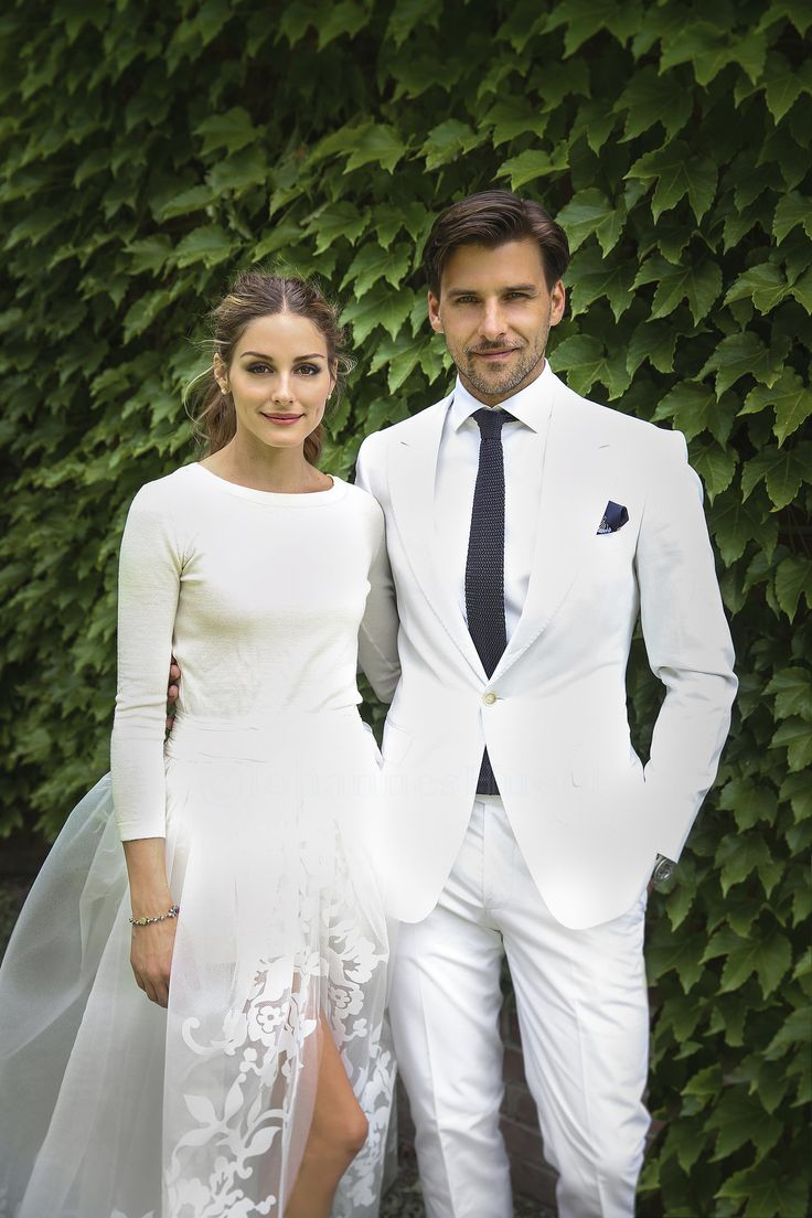 Olivia created her own bridal look with three pieces all from Carolina Herrera: a cashmere sweater and a full tulle skirt layered over a pair of white shorts. Meanwhile, Johannes chose a bespoke tailored white Marc Anthony Hamburg suit with a Marc Anthony Hamburg piqué shirt, a navy Charvet tie, and navy Etro pocket square. A picture-perfect bride and groom, no? Source: Olivia Palermo