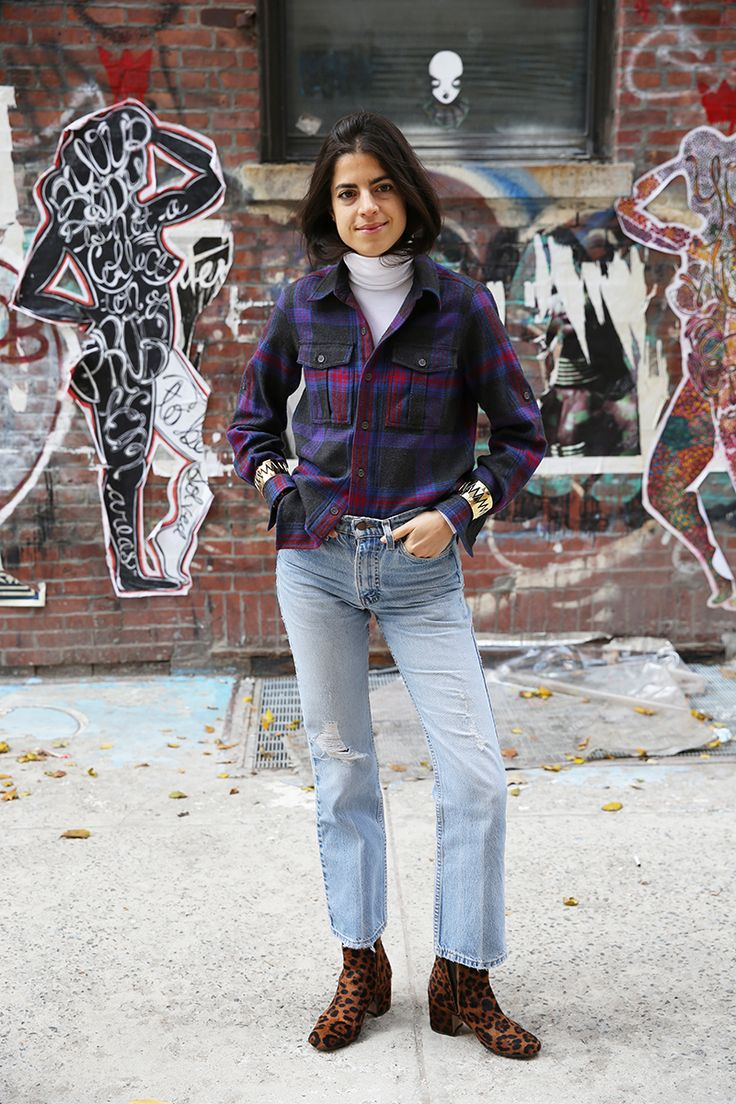 MAN REPELLER- Layer a white turtleneck under a flannel shirt, tucked into high waist straight leg jeans, with clashing/animal print ankle booties