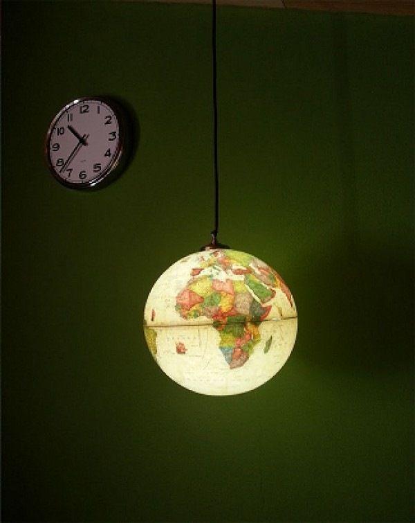 upcycled world globe into hanging pendant light decor idea