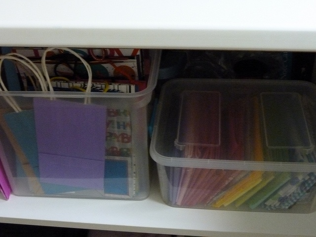 Gift Bags And Tissue Paper Are Stored In Easy To See Clear Containers In  The Cupboard