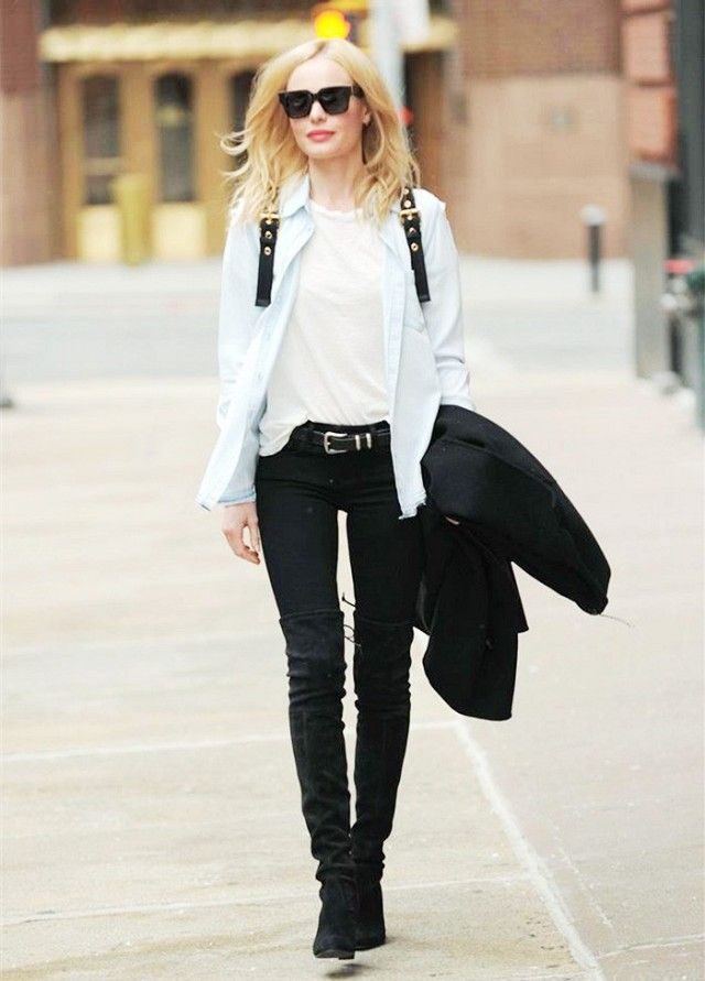 Kate Bosworth wears a denim button down, white T-shirt, black skinny jeans, and Stuart Weitzman over the knee boots with a Burberry rucksack