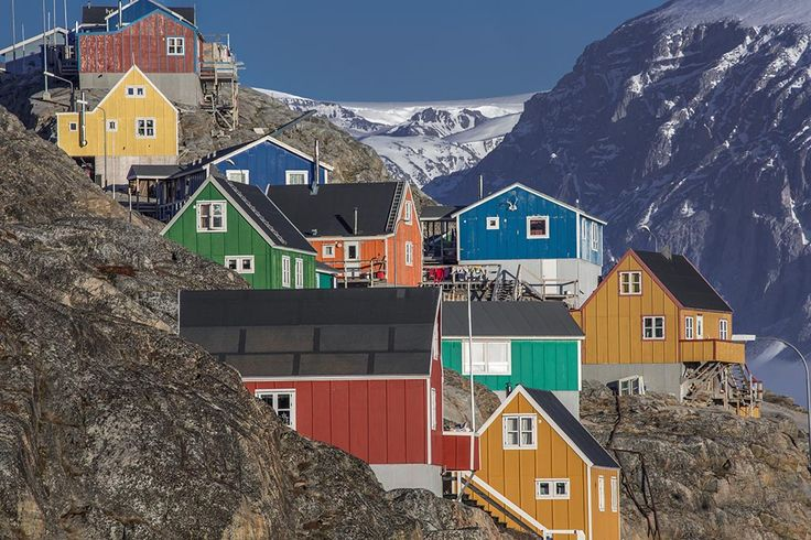 Greenland | Lawrence Hislop Photography. Colored houses on mountainside in Greenland.