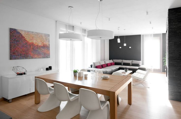 Minimalist Dining Area with White Lamps and Wooden Floor