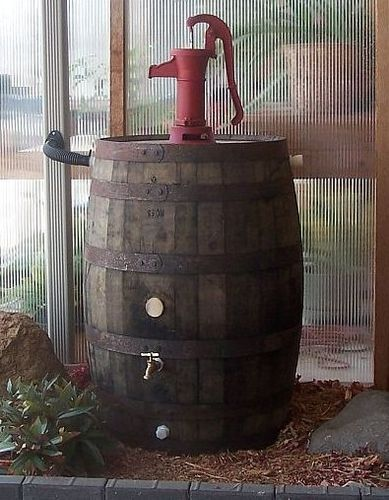 Old Whiskey Barrel Rain Barrel c/ Red Pitcher Pump--water catchment system with pump on top