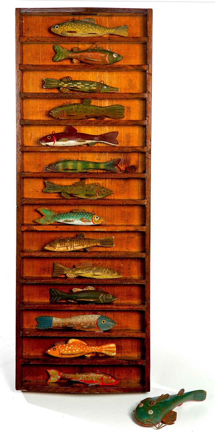 """Garth's Sale 1128 Lot 1091 Feb 06 2015.               Estimate $ 250-450.  Sold for $1,440.   FIFTEEN ICE FISHING DECOYS.  American, 20th century. Carved wooden bodies with tin fins and tack or painted eyes. Original paint. Worn. Average 7""""l. Divided box included for display .36""""h. 13""""w."""