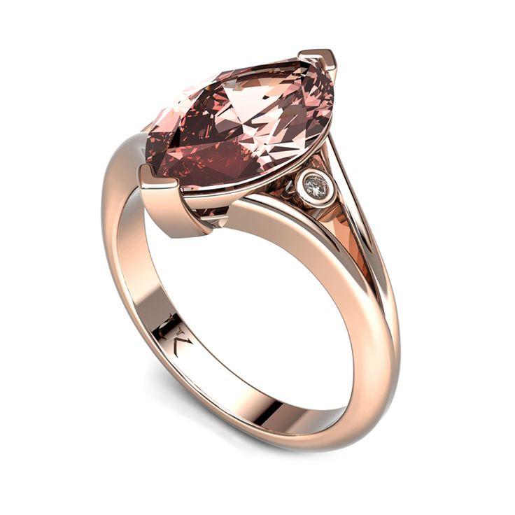 Morganite solitaire ring with diamonds in the split shank.    www.uwekoetter.com