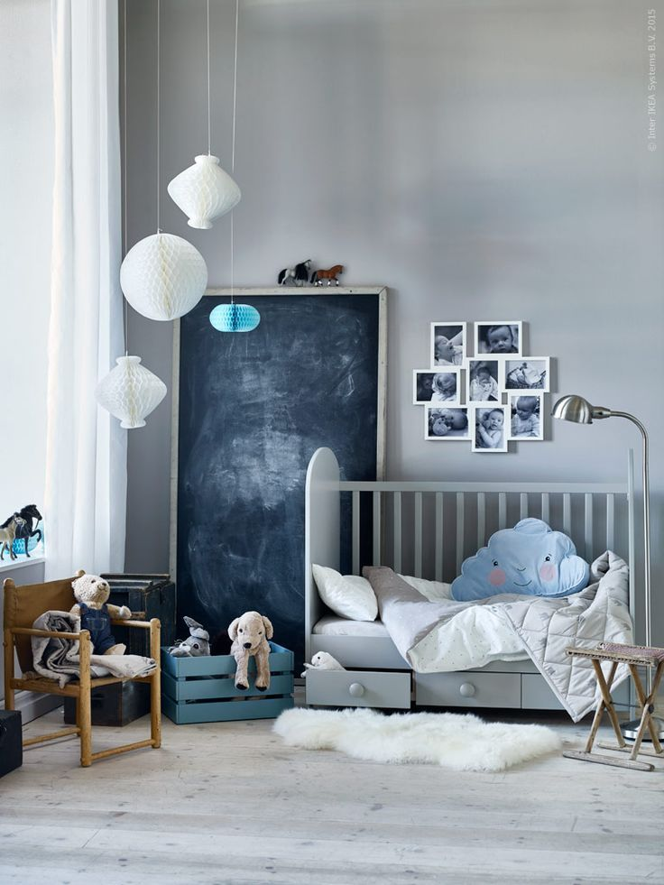 grey and blue nursery with built-in storage under the crib