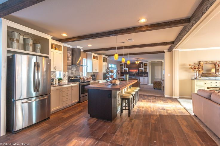 Here's how to get a Gourmet kitchen from Palm Harbor Homes in your modular home - granite, farm sink, pull out faucet, stainless, custom cabinets - we've got it all!