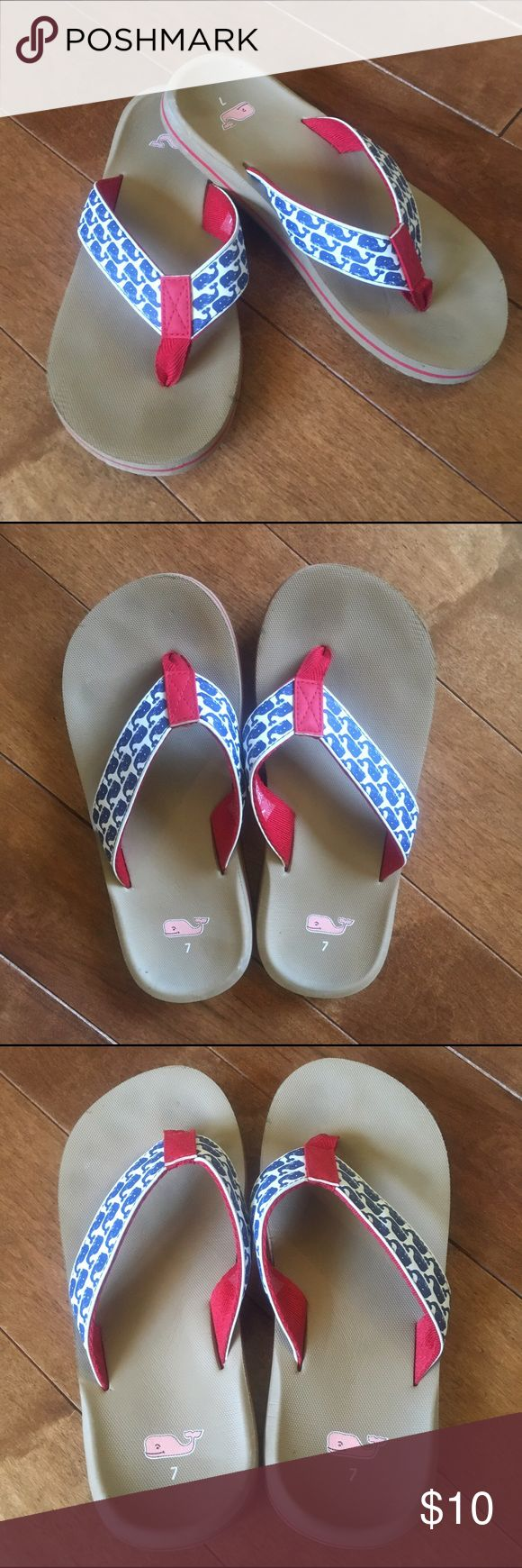 Vineyard Vines Whales Flip Flops - Size 7 Good used condition!! Most of wear is on the bottom of the shoes. Has a mark on the side of right Flip flop, and little marks on left Flip Flop heel. (See pics).                                                                Red, white, and navy blue with a tan bottom. Size 7 Vineyard Vines Shoes