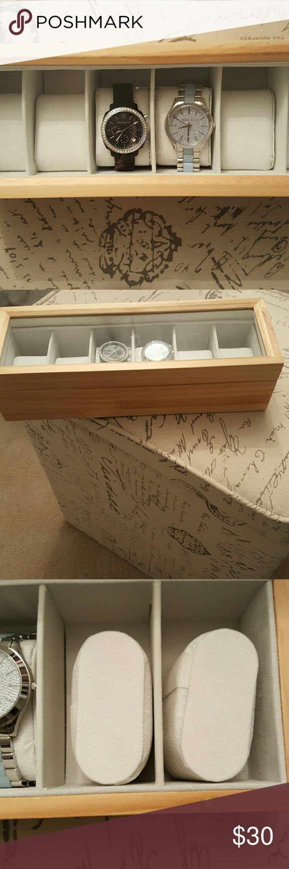 Watch display case Light grain wood, clear window like lid makes it easy to select your watch of the day. Holds 6 watches. Only used a short time because I upgraded to a larger case. Like new condition Accessories Watches