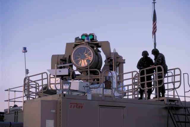 Tactical High-Energy Laser ( THEL ) atop TRW ground-based mobile operations control center in Area 51 for Israel Defense Force demonstration during January 2000. Report: http://unwantedpublicity.media.officelive.com/Gallery.aspx