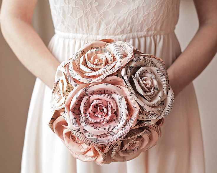 Sheet music wedding bouquet. Cool alternative to real flowers.