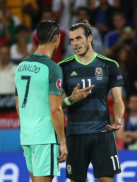 #EURO2016 Portugal's Cristiano Ronaldo and Wales' Gareth Bale after their 2016 UEFA European Football Championship semifinal match at Stade de Lyon Team...