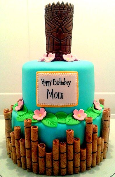 Hawaiian Tiki Cake - Made this cake for a client celebrating her mother's 50th birthday. Mask and leaves are made out of fondant. Flowers are gumpaste and bamboo is made with rolled wafers and food coloring.