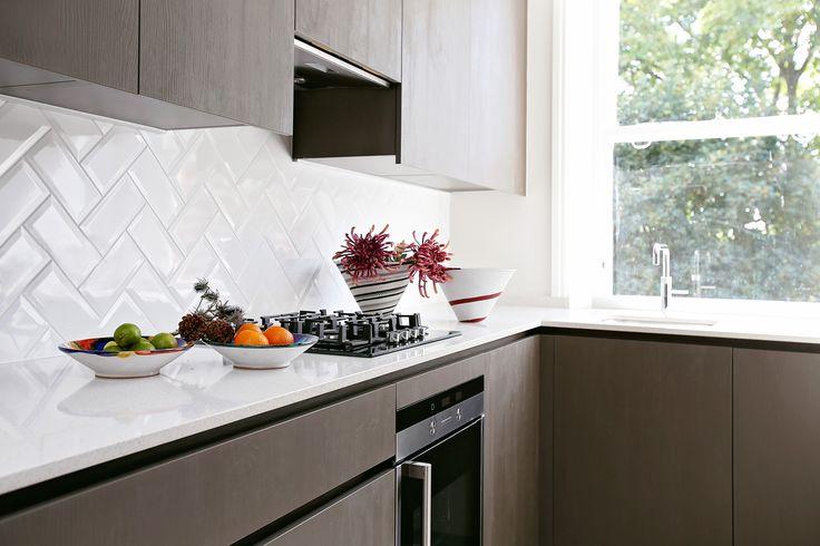Herringbone tiles as a simple but effective splashback in this beautiful Eggersman kitchen