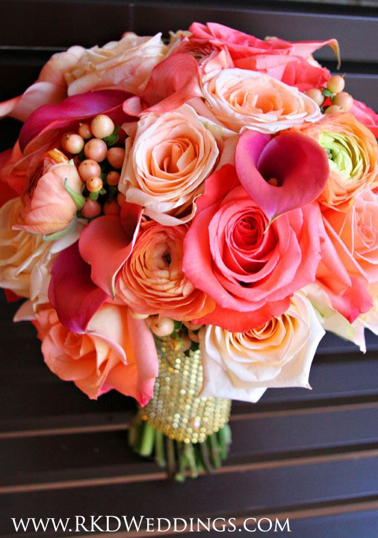 "Stunning shades of ALL coral in this bouquet! Movie Star roses, Tiffany roses, Donna roses, coral/peach ranunculus, coral hypericum berries and coral ""Passion Fruit"" calla lilies."