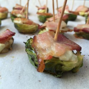 An easy Super Bowl snack of roasted Brussels sprouts, bacon, & blue cheese that won't derail you from your nutrition and fitness goals.