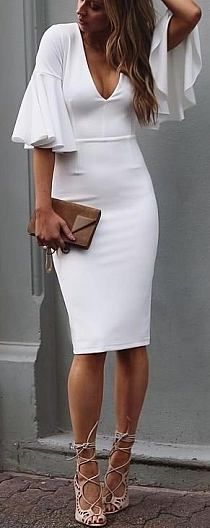 Lovely body con white midi with ruffle sleeves.