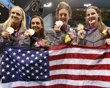 Women's swimming relay team.  (L-R) Dana Vollmer, Rebecca Soni, Allison Schmitt and Missy Franklin of the U.S. pose with their gold medals and national flag after winning the women's 4x100m medley relay final. (Reuters)