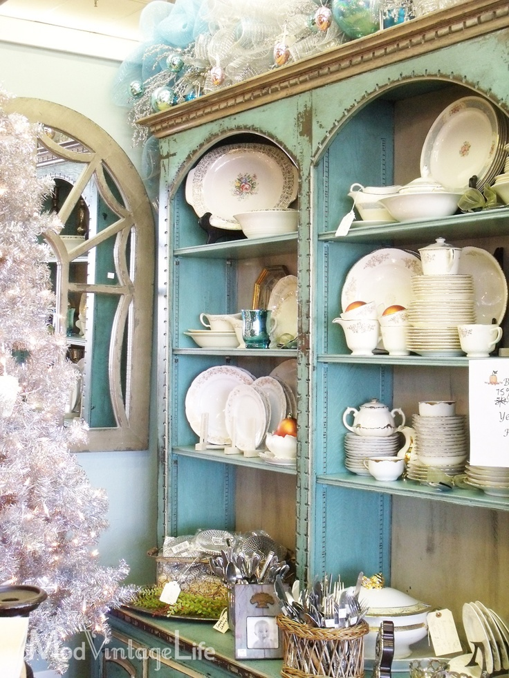 Gorgeous turquoise buffet with vintage dishes!