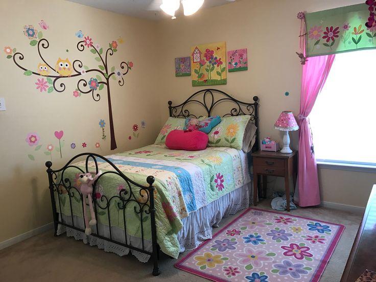Young girl's daisy room with Pottey Barn bedding & valance, scroll tree wall decals, canvas print wall art & daisy rug.