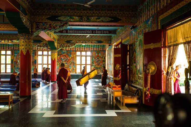 Nomdraling Monastery in Coorg, Karnataka, India, is a refuge for Tibetans. In this picture you see a monk carrying his study desk after prayer time.