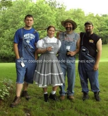 Hillbillys Costume: A redneck hillbilly retirement party in West Virginia was the inspiration for these costumes. The guys wore thrift store bib-overhauls.  My dress from