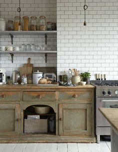 photo by paul-Massey - wonderful unfitted country kitchen. Love the antique cabinet paired with classic white subway tile