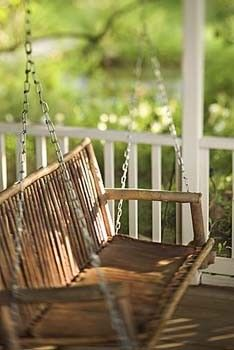 This is an article that describes how to build a porch swing. The article says to use treated lumber - but the photo looks like sticks....Hmmm.