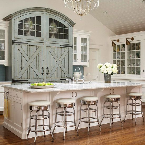 The blue-gray barn-style doors create an eye-catching focal point in this country kitchen. More blue kitchen design ideas: http://www.bhg.com/kitchen/color-schemes/inspiration/blue-kitchen-design-ideas/?socsrc=bhgpin071613barndoors=10