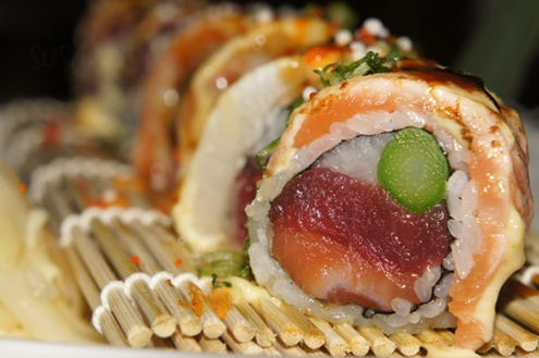 2011 Roll: tuna, salmon, yellowtail and asparagus inside. It is covered with tuna, yellowtail and tobiko and drizzled with eel sauce and spicy mayo.